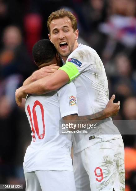 Harry Kane of England and Raheem Sterling of England celebrate following their sides victory in the UEFA Nations League A group four match between...