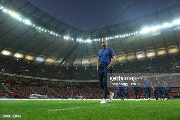 Harry Kane of England and teammates inspect the pitch prior to the 2022 FIFA World Cup Qualifier match between Poland and England at Stadion Narodowy...