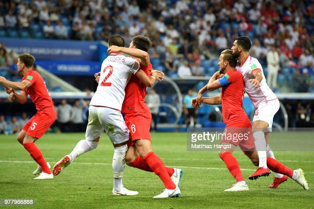Harry Kane of England and Yassine Meriah of Tunisia clash during the 2018 FIFA World Cup Russia group G match between Tunisia and England at...