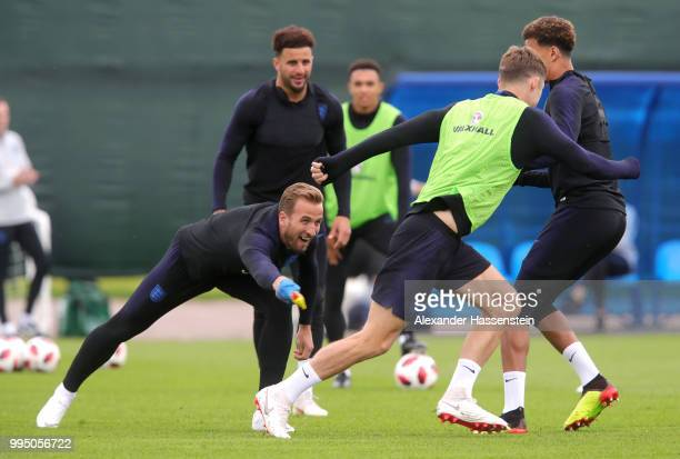 Harry Kane of England attemtps to tag Gary Cahill of England with a toy chicken during the England training session on July 10 2018 in Saint...