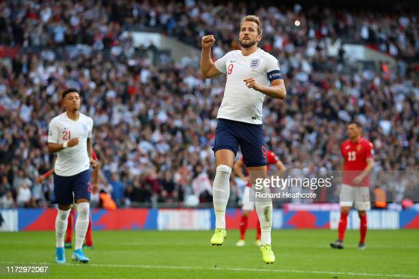 Harry Kane of England celebrates after he scores his sides fourth goal from the penalty spot during the UEFA Euro 2020 qualifier match between...