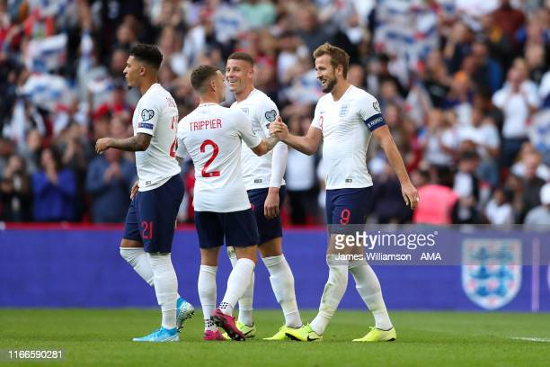 Harry Kane of England celebrates after scoring a goal to make it 40 completing his hat trick with Kieran Tripper during the UEFA Euro 2020 qualifier...
