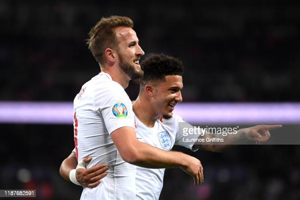 Harry Kane of England celebrates after scoring his sides third goal with Jadon Sancho during the UEFA Euro 2020 qualifier between England and...