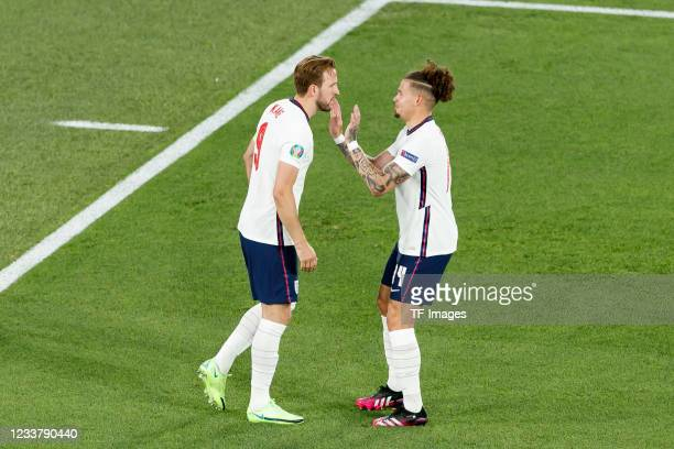 Harry Kane of England celebrates after scoring his team's first goal with Kalvin Phillips of England during the UEFA Euro 2020 Championship...
