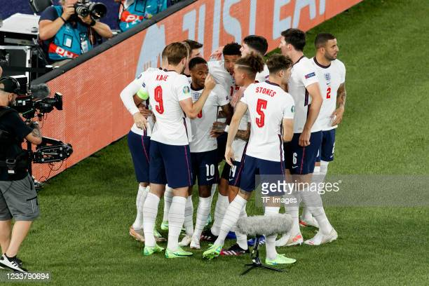 Harry Kane of England celebrates after scoring his team's first goal with teammates during the UEFA Euro 2020 Championship Quarter-final match...