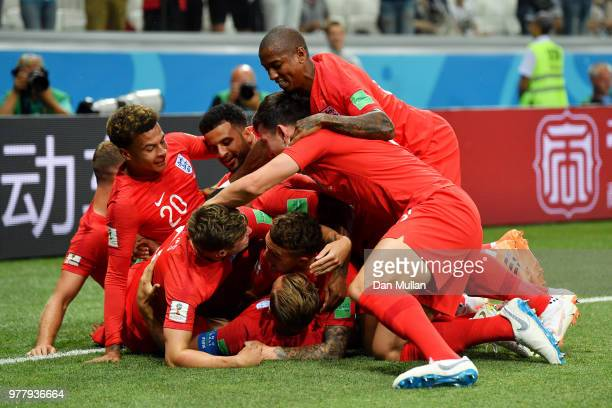 Harry Kane of England celebrates after scoring his team's first goal with team mates during the 2018 FIFA World Cup Russia group G match between...