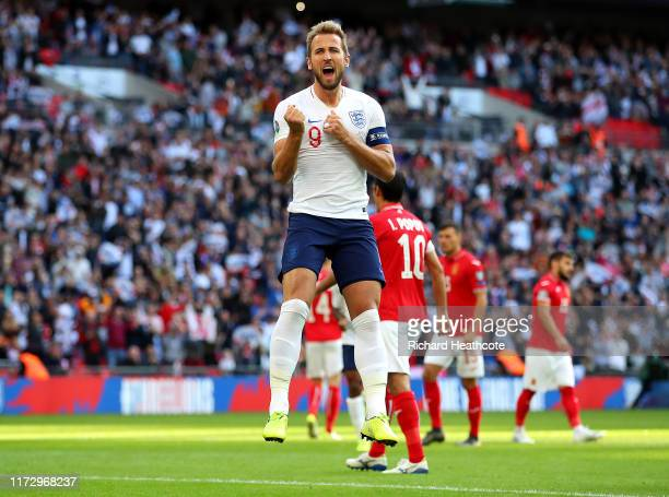 Harry Kane of England celebrates after scoring his team's second goal from the penalty spot during the UEFA Euro 2020 qualifier match between England...