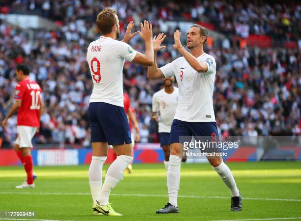 Harry Kane of England celebrates after scoring his team's second goal from the penalty spot with Jordan Henderson of England during the UEFA Euro...