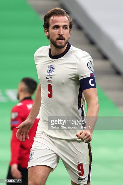 Harry Kane of England celebrates after scoring their side's first goal during the FIFA World Cup 2022 Qatar qualifying match between Albania and...