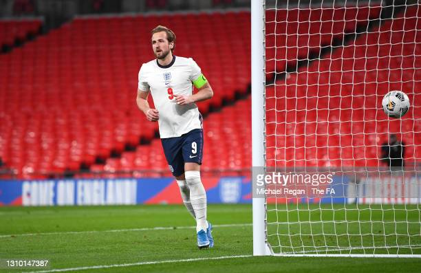 Harry Kane of England celebrates after scoring their side's first goal from the penalty spot during the FIFA World Cup 2022 Qatar qualifying match...