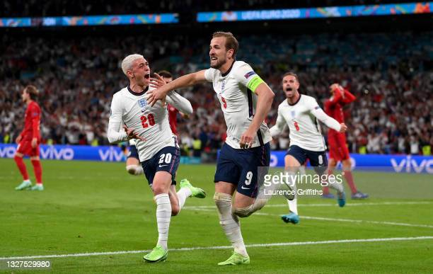 Harry Kane of England celebrates after scoring their side's second goal from the penaduring the UEFA Euro 2020 Championship Semi-final match between...