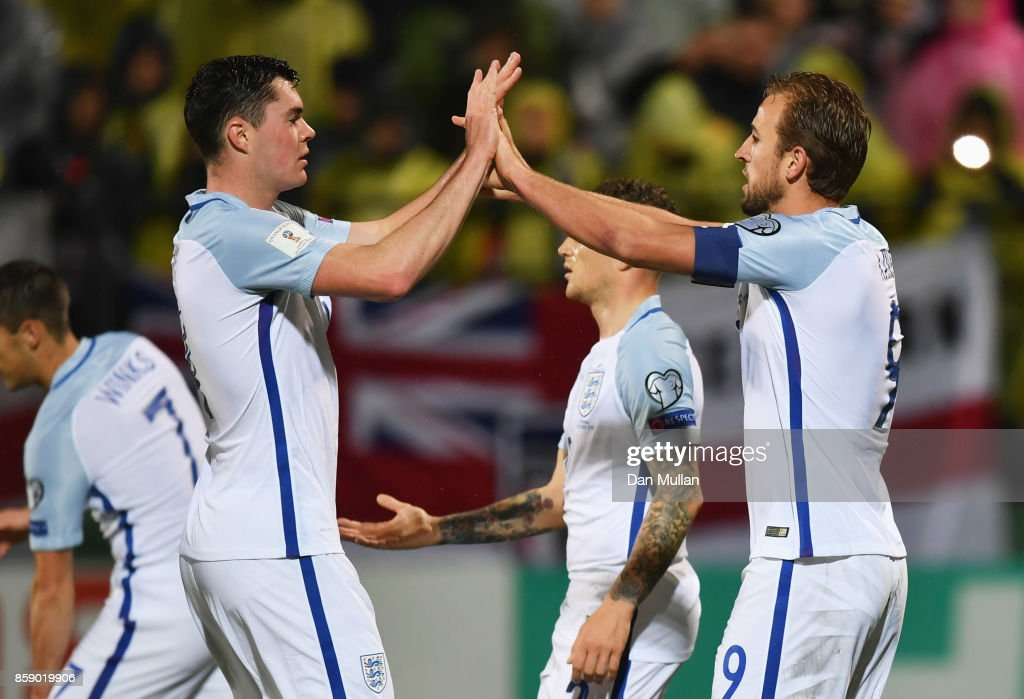 Harry Kane of England celebrates as he scores their first goal from the penalty spot with Michael Keane during the FIFA 2018 World Cup Group F Qualifier between Lithuania and England at LFF Stadium on October 8, 2017 in Vilnius, Lithuania.