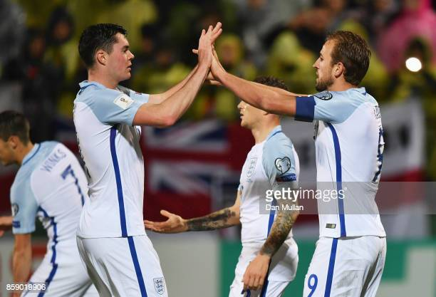 Harry Kane of England celebrates as he scores their first goal from the penalty spot with Michael Keane during the FIFA 2018 World Cup Group F...