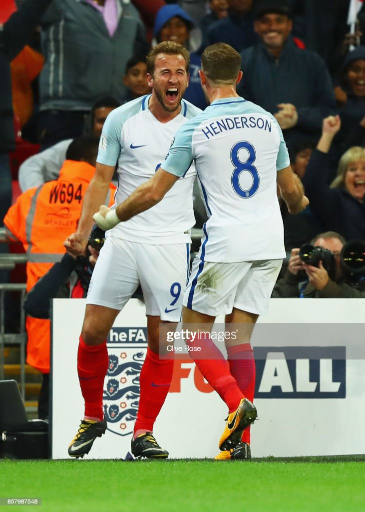Harry Kane of England (9) celebrates as he scores their first goal with Jordan Henderson of England during the FIFA 2018 World Cup Group F Qualifier between England and Slovenia at Wembley Stadium on October 5, 2017 in London, England.