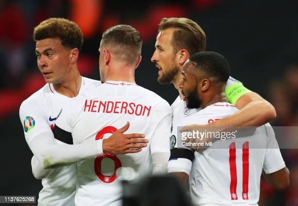 Harry Kane of England celebrates as scores his team's second goal from a penalty with Raheem Sterling Jordan Henderson and Dele Alli during the 2020...