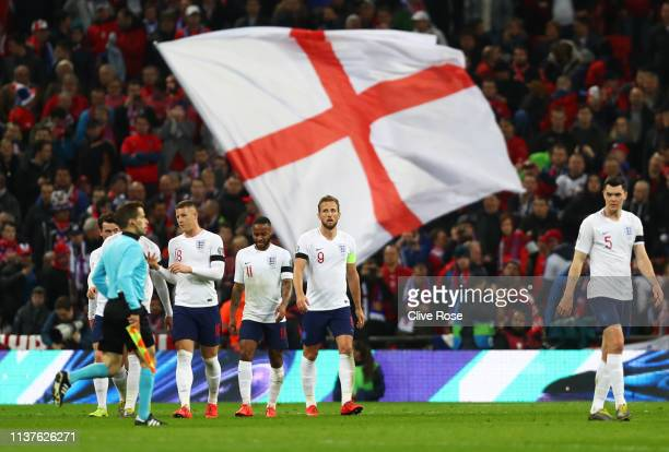 Harry Kane of England celebrates as scores his team's second goal from a penalty with team mates during the 2020 UEFA European Championships Group A...