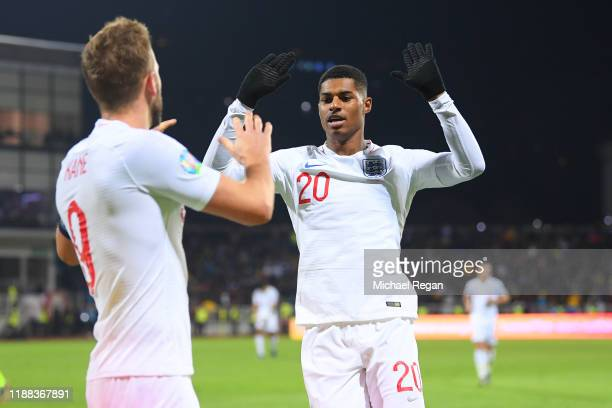 Harry Kane of England celebrates his goal with team mate Marcus Rashford during the UEFA Euro 2020 Qualifier between Kosovo and England on November...
