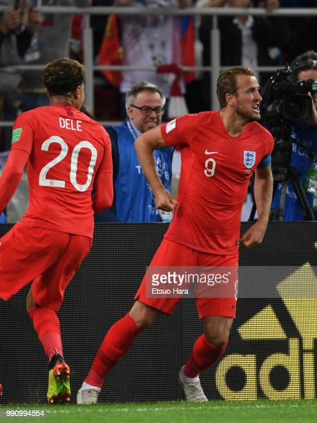 Harry Kane of England celebrates scoring his side's first goal from the penalty during the 2018 FIFA World Cup Russia Round of 16 match between...