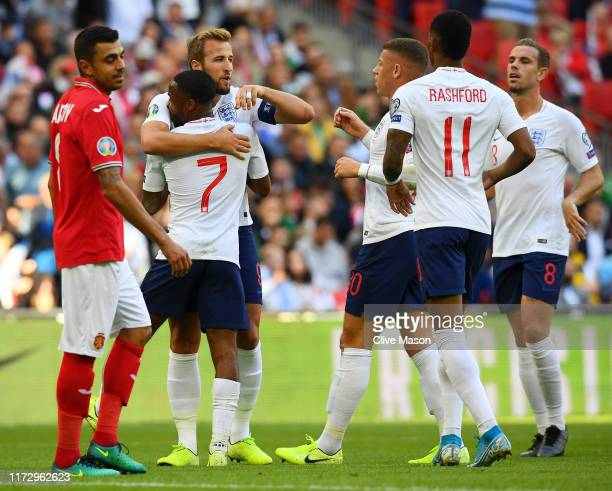 Harry Kane of England celebrates scoring his team's first goal with Raheem Sterling of England during the UEFA Euro 2020 qualifier match between...