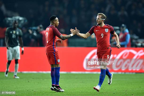 Harry Kane of England celebrates scoring his team's first goal with his team mate Nathaniel Clyne during the International Friendly match between...