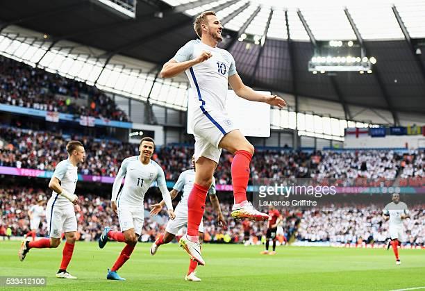 Harry Kane of England celebrates scoring the opening goal during the International Friendly match between England and Turkey at Etihad Stadium on May...