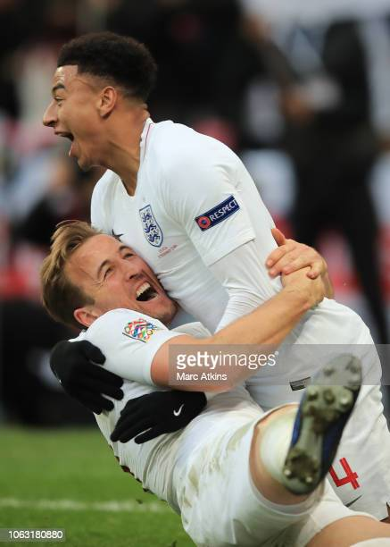 Harry Kane of England celebrates scoring their 2nd goal with Jesse Lingard during the UEFA Nations League A group four match between England and...