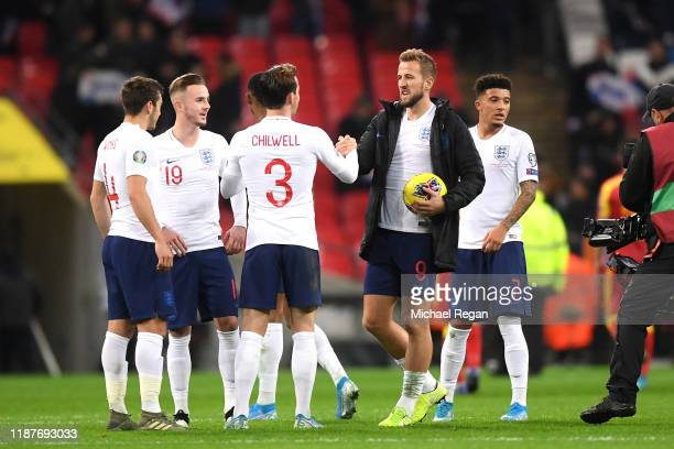 Harry Kane of England celebrates with Ben Chilwell as he claims the match ball during the UEFA Euro 2020 qualifier between England and Montenegro at...