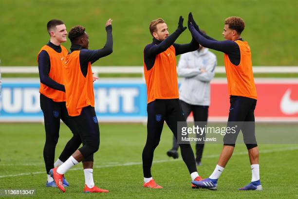 Harry Kane of England celebrates with Dele Alli of England during an England training session during an England Media Access day at St Georges Park...