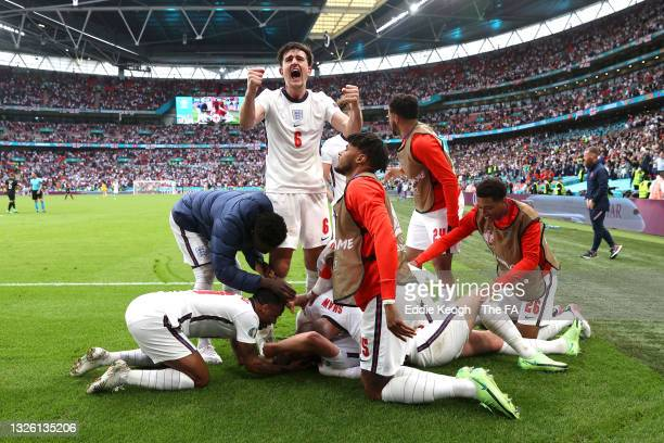 Harry Kane of England celebrates with Harry Maguire and team mates after scoring their side's second goal during the UEFA Euro 2020 Championship...