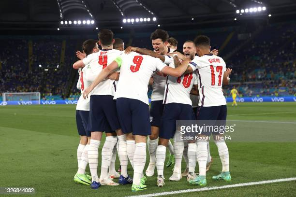 Harry Kane of England celebrates with Harry Maguire, Luke Shaw and team mates after scoring their side's third goal during the UEFA Euro 2020...