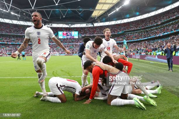 Harry Kane of England celebrates with Kyle Walker and team mates after scoring their side's second goal during the UEFA Euro 2020 Championship Round...