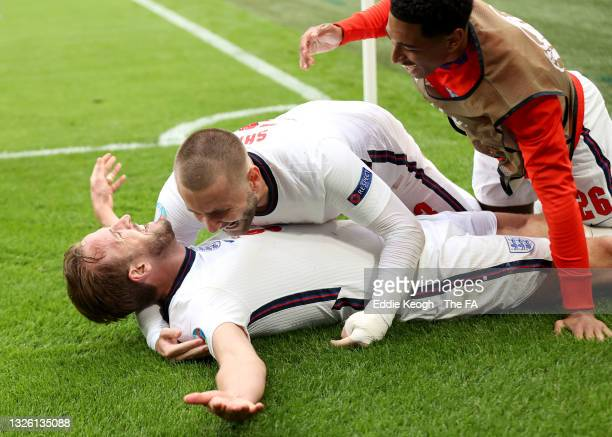 Harry Kane of England celebrates with Luke Shaw and Jude Bellingham after scoring their side's second goal during the UEFA Euro 2020 Championship...