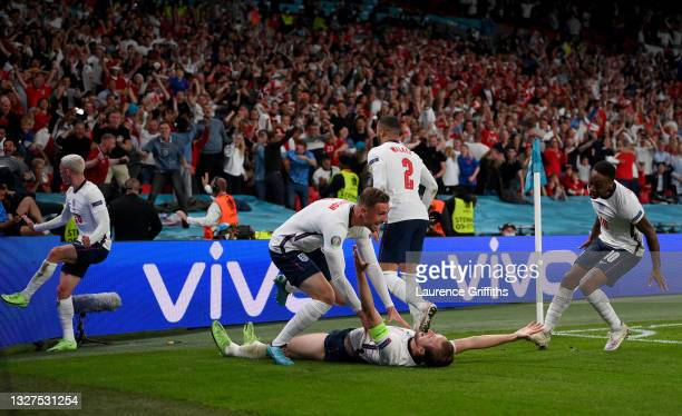 Harry Kane of England celebrates with Phil Foden, Kyle Walker, Jordan Henderson and Raheem Sterling after scoring their side's second goal during the...