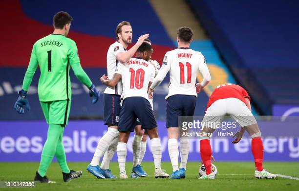 Harry Kane of England celebrates with Raheem Sterling and Mason Mount after scoring their side's first goal from the penalty spot during the FIFA...
