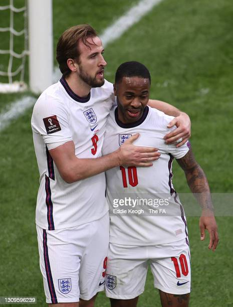 Harry Kane of England celebrates with team mate Raheem Sterling after scoring their side's first goal during the FIFA World Cup 2022 Qatar qualifying...
