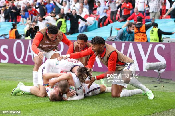 Harry Kane of England celebrates with team mates after scoring their side's second goal during the UEFA Euro 2020 Championship Round of 16 match...