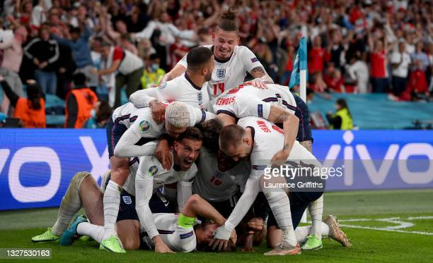Harry Kane of England celebrates with team mates after scoring their side's second goal during the UEFA Euro 2020 Championship Semi-final match...