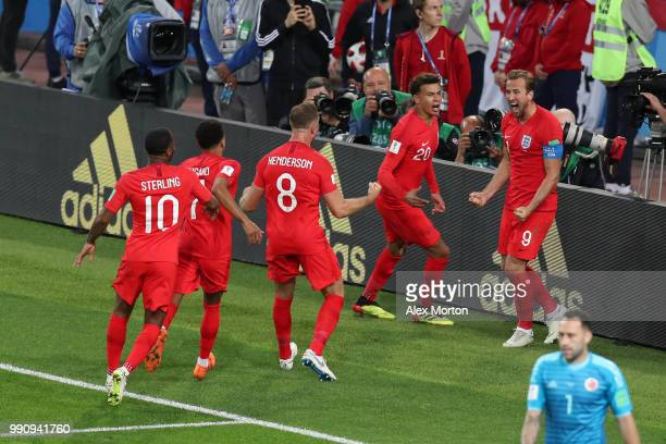 Harry Kane of England celebrates with team mates scoring the opening goal from a penalty during the 2018 FIFA World Cup Russia Round of 16 match...