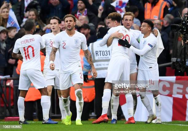 Harry Kane of England celebrates with teammates after scoring his team's second goal during the UEFA Nations League A group four match between...