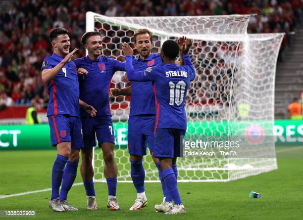 Harry Kane of England celebrates with teammates after scoring their team's second goal during the 2022 FIFA World Cup Qualifier match between Hungary...