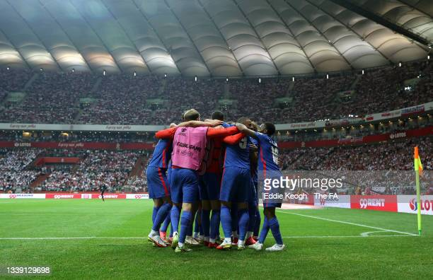 Harry Kane of England celebrates with teammates after scoring their team's first goal during the 2022 FIFA World Cup Qualifier match between Poland...