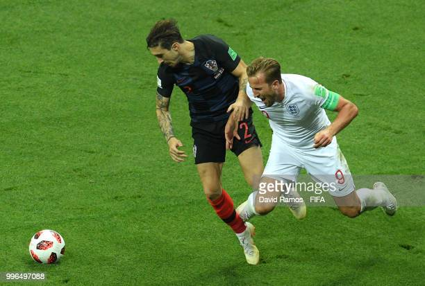 Harry Kane of England clashes with Lovre Kalinic of Croatia during the 2018 FIFA World Cup Russia Semi Final match between England and Croatia at...