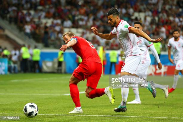 Harry Kane of England competes with Anice Badri of Tunisia during the 2018 FIFA World Cup Russia group G match between Tunisia and England at...