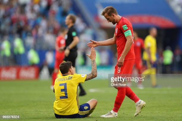 Harry Kane of England consoles Victor Lindelof of Sweden following the 2018 FIFA World Cup Russia Quarter Final match between Sweden and England at...