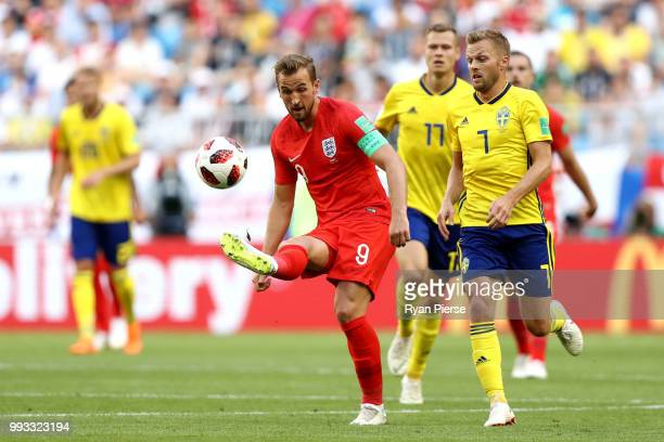 Harry Kane of England controls the ball under pressure from Sebastian Larsson during the 2018 FIFA World Cup Russia Quarter Final match between...