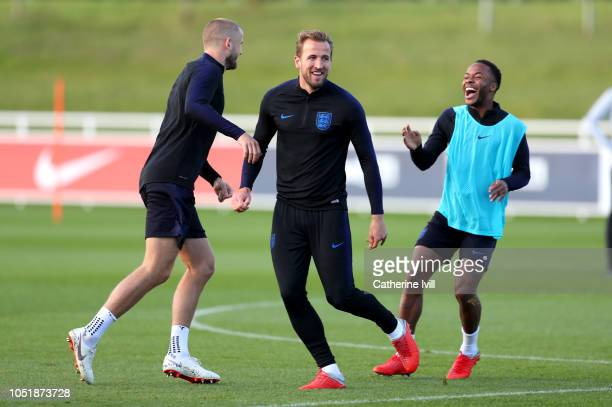 Harry Kane of England Eric Dier of England and Raheem Sterling of England laugh during the England Training Session at St Georges Park on October 11...
