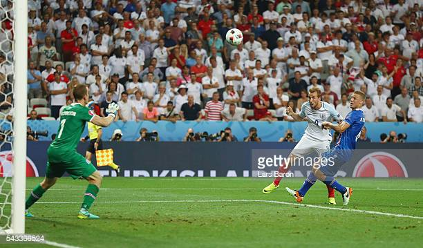 Harry Kane of England heads the ball during the UEFA EURO 2016 round of 16 match between England and Iceland at Allianz Riviera Stadium on June 27...