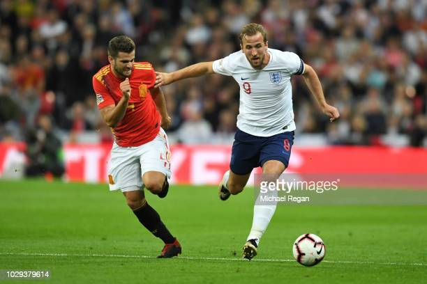 Harry Kane of England holds off Nacho Fernandez of Spain during the UEFA Nations League A group four match between England and Spain at Wembley...