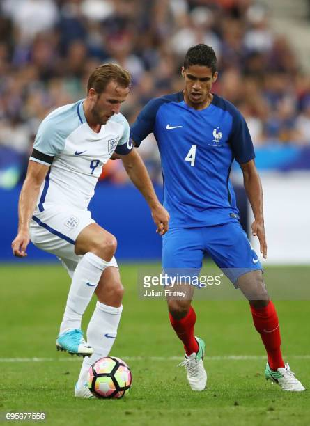 Harry Kane of England holds off Raphael Varane of France during the International Friendly match between France and England at Stade de France on...