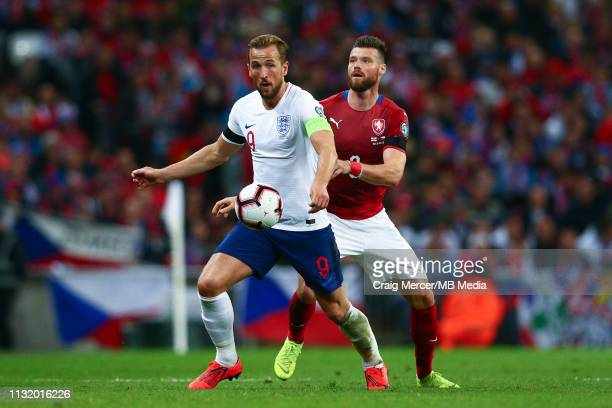 Harry Kane of England holds off the challenge from Ondrej Celustka of Czech Republic during the 2020 UEFA European Championships group A qualifying...